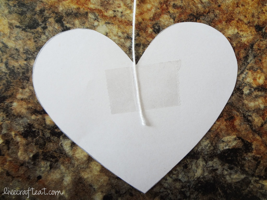 hanging hearts decoration using tape and paper and string