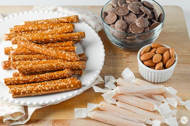 pretzel rods, chocolate, almonds, and homemade caramel = homemade pretzel rods. delicious!!
