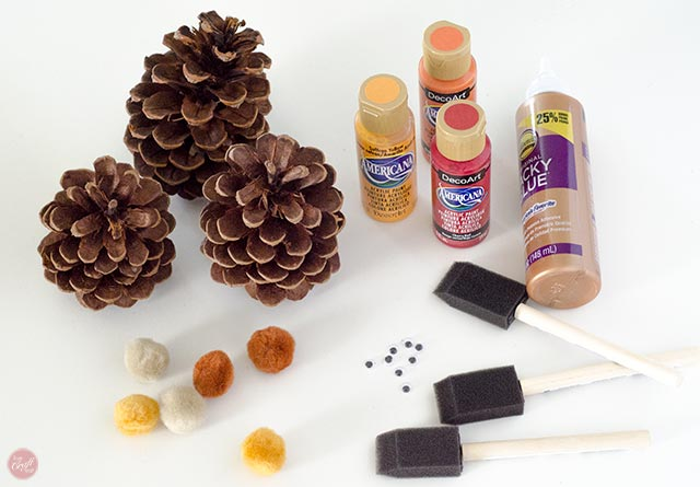 pinecones, paint, brushes, pom poms, googly eyes, and glue = easy supplies for a really cute pinecone turkey craft