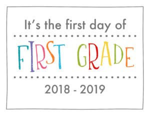 back to school sign rainbow colors first grade